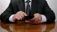 Business man typing on cell phone video