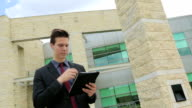 Business man uses a tablet. video