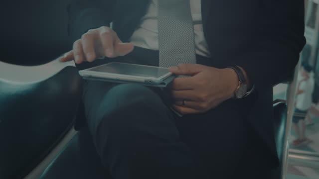 Business man using digital tablet video