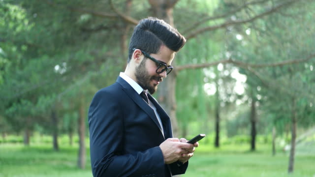 Business man using mobile smart phone video