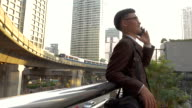 Business man using smart phone in modern city video