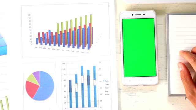 Business man using smart phone with green screen video