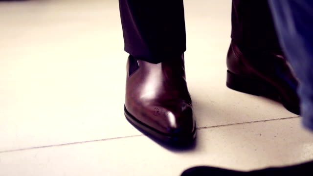 Business man with suit and brown leather shoes video