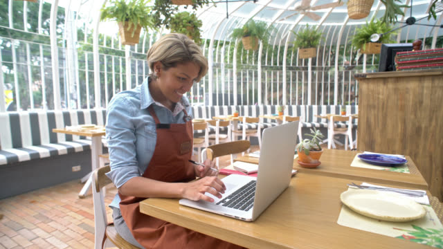 Business manager doing the books at a restaurant video