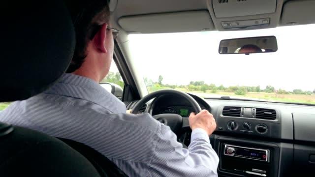 Business man's hands driving a modern car video