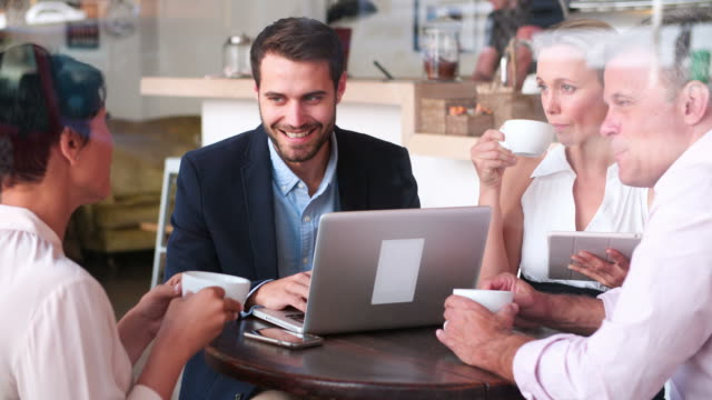 Business meeting in a cafe video