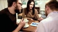 Business meeting in cafe. team is using the tablet video