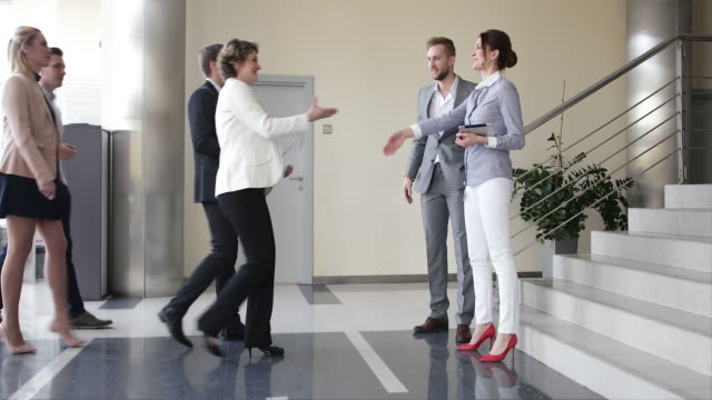Business meeting in the office building lobby video