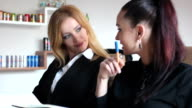 Business meeting, smiling business women video