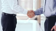 SLO MO LD Business men shaking hands video