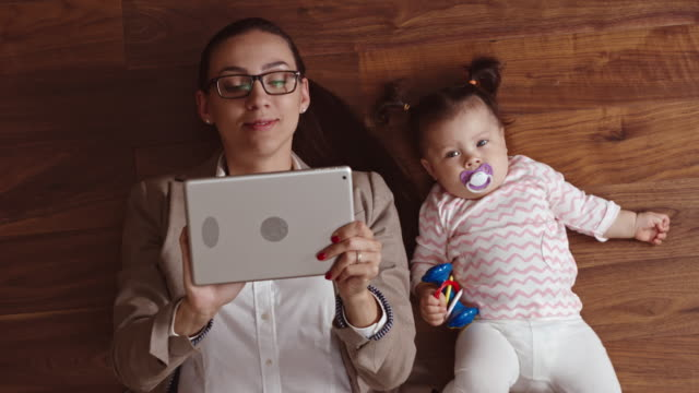 Business mom working with her baby nearby video