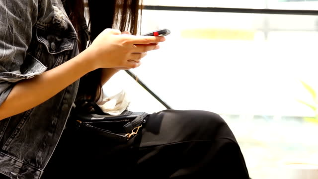 Business on the Go : Beautiful girl using her mobile phone in cafe. video