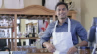 Business Owner Smiles Behind Bar video