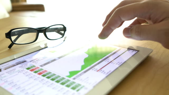 Business people analysing financial stock market data video