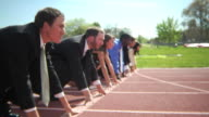 Business people at starting line video