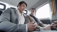 Business people city taxi ride video