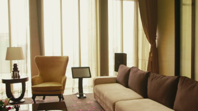 Business people, couple, hotel suite room, husband, wife, luxury home video