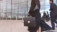 Business people enter city offices video