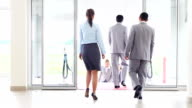 Business people going in and out. video