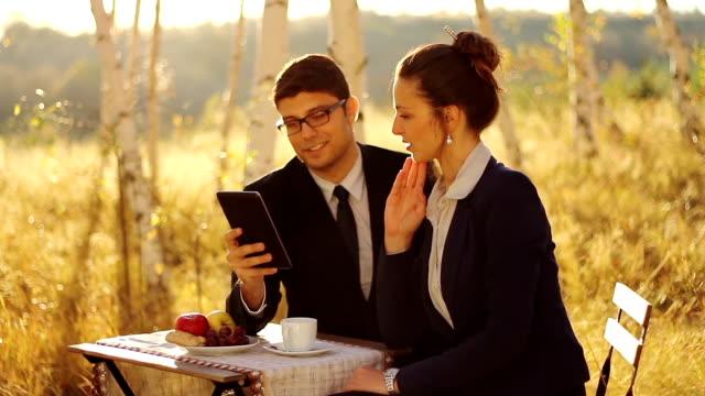 Business People having breakfast using tablet video