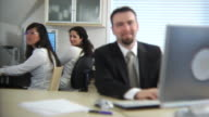 Business people in office working video