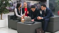 Business People Interacting in Lobby video
