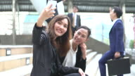 Business people making photos on mobile or smart phone and happy smiling. Workers having break time. Business concept. video