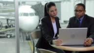 Business people meet and discuss at airport video