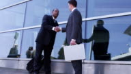 Business people meet and shake hands video