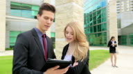 Business people meet looking at tablet. video