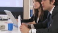 Business people meeting in large office video