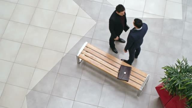 Business People Meeting In Lobby video