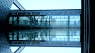 business people. modern glass building. mirror reflection. group team video