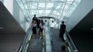 Business people on escalator video