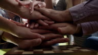 Business people putting hands together video