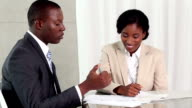 Business people reaching an agreement video