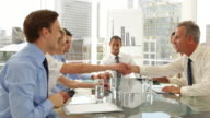 Business people shaking hands at a meeting video