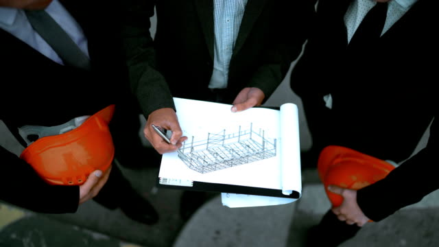 Business people sign architecture documents video