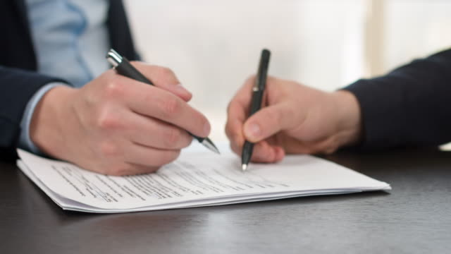 Business people signing sales agreement contract. video