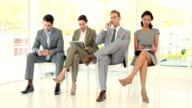 Business people sitting and waiting video