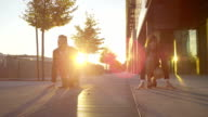 SLOW MOTION: Business people sprint down the business district video