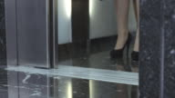 SLO MO DS Business people stepping out of elevator video