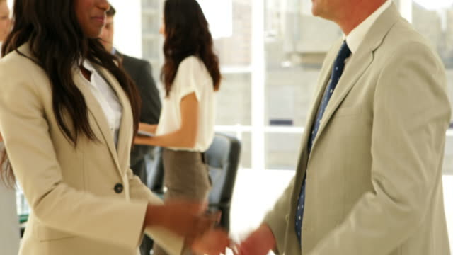 Business people talking together and shaking hands video