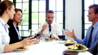 Business people toasting and having lunch video