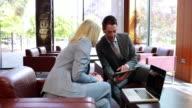 Business people using digital tablet in meeting video