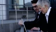 Business people using digital tablet video