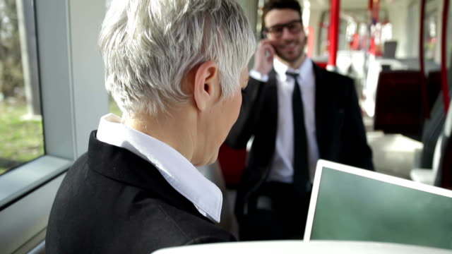 Business people using public transport video