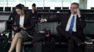 Business people wait in airport lobby video
