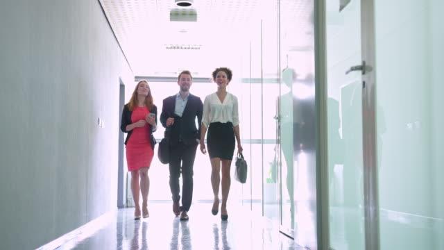 Business people walking in corridor video