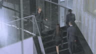 TD Business people walking on the staircase in corporate building video